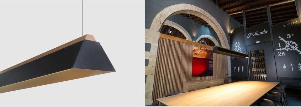 Luminaria suspendida lineal de madera modelo Alpha para iluminación de bodegas y salones
